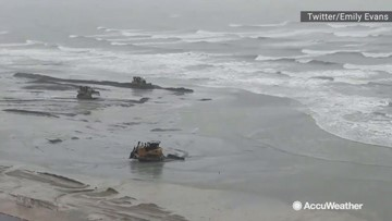 Bulldozers build up beach during Tropical Storm Imelda