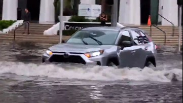 Cars plow through severe flooding in Miami