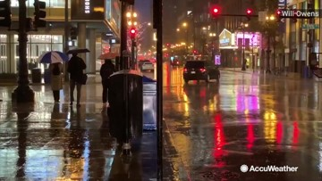 Umbrellas and jackets needed for morning commuters