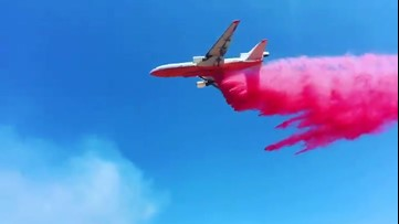 Air tanker drops retardant over Arizona fire