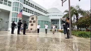 Saluting the fallen during a rainy Memorial Day