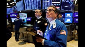 Bonds are up, stocks fall amid fears virus will hurt economies