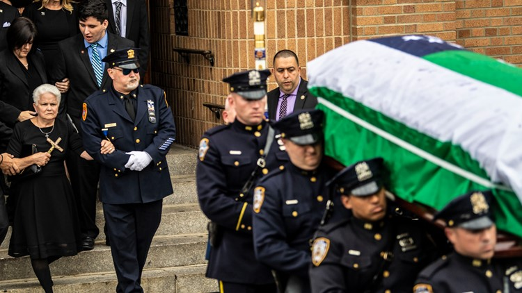 Sept 11 Attacks-First Responder Dies funeral walking out