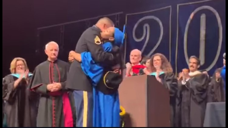 Military dad surprises daughter at graduation
