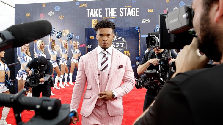Oklahoma quarterback Kyler Murray NFL Draft Football walking red carpet
