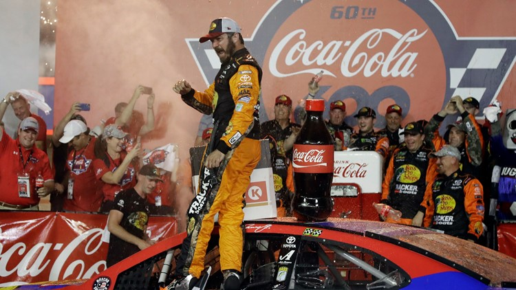 Truex Jr in Victory lane at NASCAR Charlotte Auto Racing
