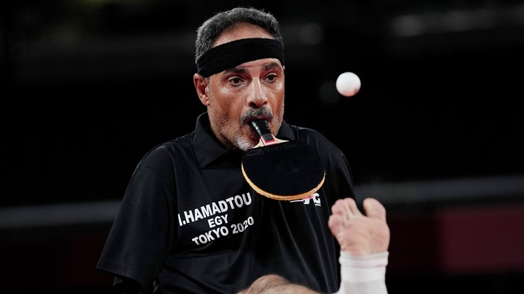 Armless table tennis player who holds paddle in mouth is inspiration at Paralympics