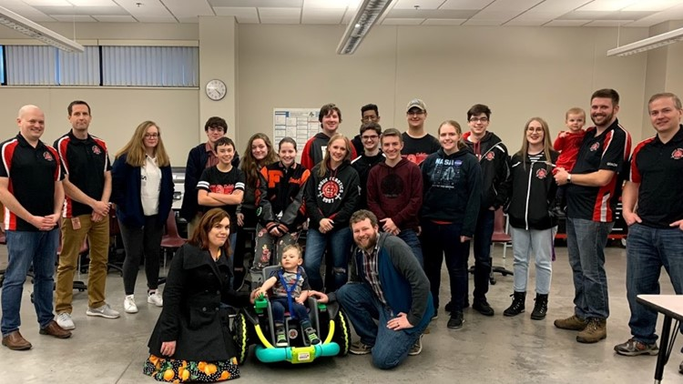 The members of the Farmington High School Robotics Team on the day they presented Cillian Jackson with the power wheelchair they built for him