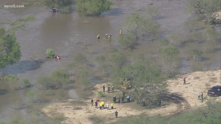 5-year-old girl's body pulled from submerged car after severe flooding; second victim expected to be recovered Friday