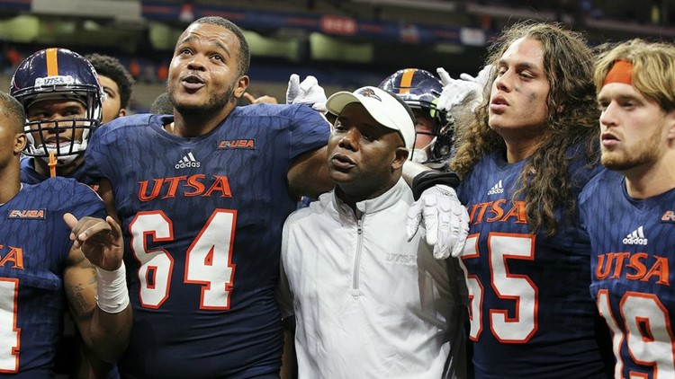 Coach Frank Wilson, singing the school alma mater after the Roadrunners beat Marshall to become bowl eligible, is 12-12 in two seasons at UTSA.