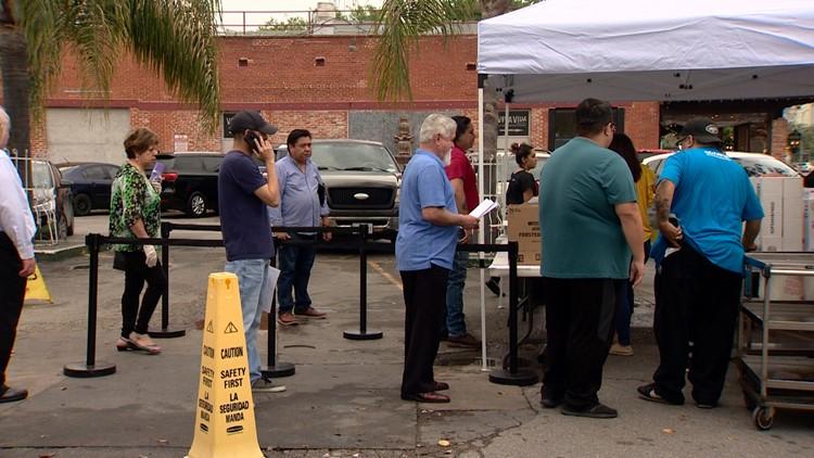 Line to buy groceries in the Mi Tierra parking lot