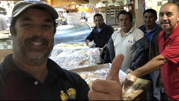 Bakers stuck by floods bake bread for evacuees