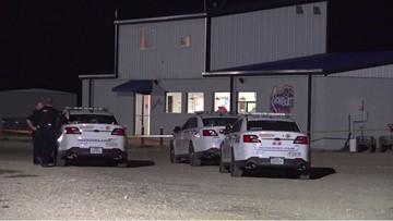 Woman shoots, kills robber armed with a baseball bat at drive-in, deputies say