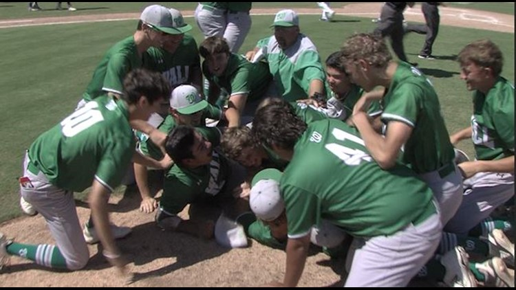 The Wall Hawks pile on each other at the mound moments after winning their school's first baseball title.