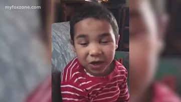 Little boy brings light to the world singing a Bob Marley song