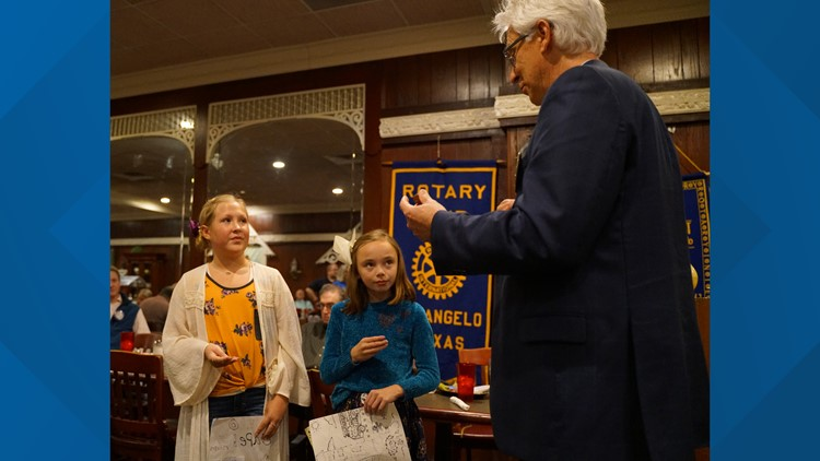 Clifton Jones presents Rotary coins to fire prevention poster winners
