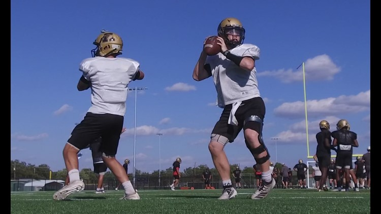 Abilene quarterbacks Eric Abbe (R) and Matthew Ezzell practice before the showdown with the Central Bobcats