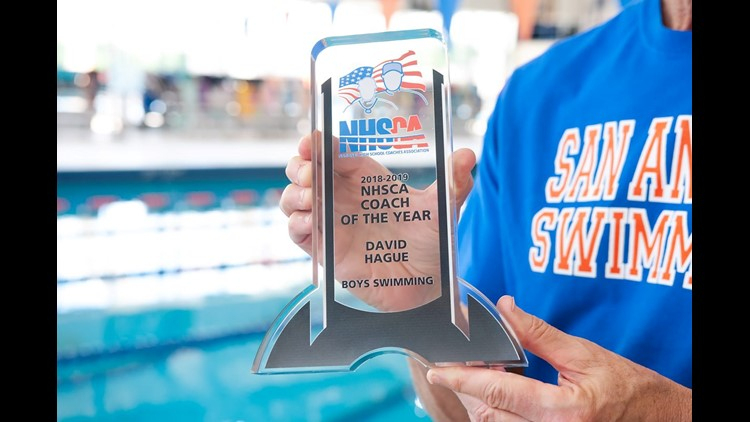 Central High swim coach David Hague shows off the hardware