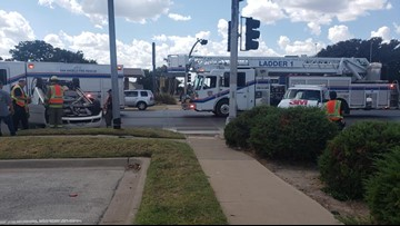 Two vans collide, one rolls over at Harris and Abe