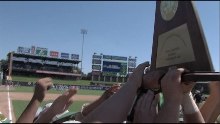 The Wall Hawks lift their school's first state baseball championship trophy.