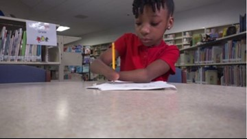 3rd grader born without hands wins national penmanship award