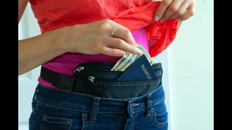 Using a money belt can help keep you safe from pickpockets. Photo by Mike Focus / Shutterstock.