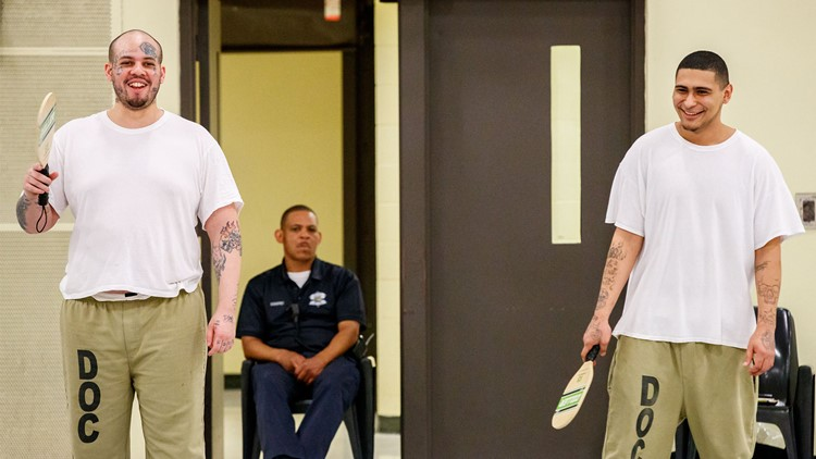 Inmates Ryan Ratliff (left) and Alberto Manzo of Chicago play pickleball at the Cook County Jail.