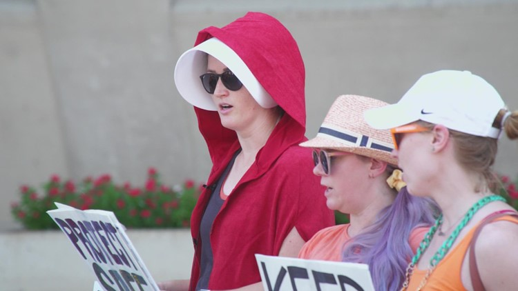 'Handmaid's Tale'-themed protest held in Dallas as new 'heartbeat' abortion law takes effect