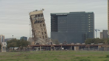 The 'Leaning Tower of Dallas' still stands after crews worked to bring it down Monday
