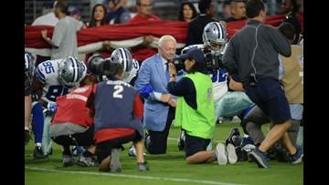 Cowboys kneel before anthem, lock arms during it