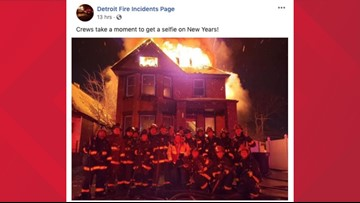 Photo of Detroit firefighters posing in front of burning house under investigation